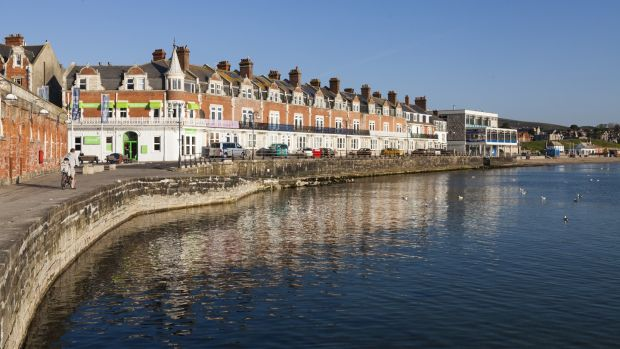Promenade and sea wall at Swanage in the early morning sunshine. Photograph: Peter Noyce/Getty Images