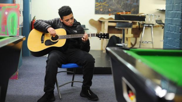Justin Anene (13) plays guitar in the Swan youth services music group in the Swan Centre in Ballybough, Dublin. Photograph: Aidan Crawley