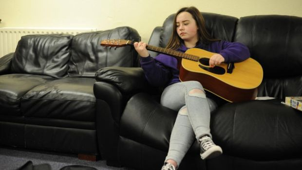 Megan Kavanagh (16) playing guitar in the Swan youth services music group in the Swan Centre in Ballybough, Dublin. Photograph: Aidan Crawley