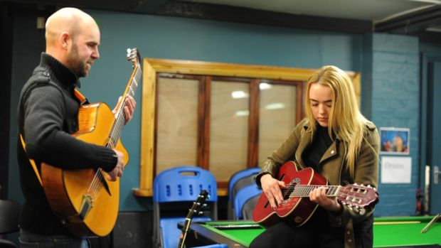 Jessica Kirwan (17) learns guitar from Brendan Maher at the Swan Youth Services in Ballybough, Dublin. Photograph: Aidan Crawley