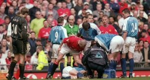 Manchester United's Roy Keane shouts at Alf-Inge Haaland after a red card tackle that contributed to the end of the Manchester City player's career. Photograph: Gary M Prior/Allsport/Getty Images