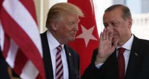 US president Donald Trump welcomes President Recep Tayyip Erdogan of Turkey outside the West Wing of the White House on Tuesday. Photograph:  Alex Wong/Getty Images