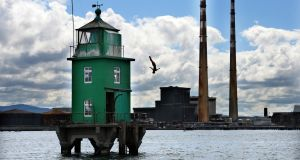 THRILL SEEKER: Anna Bader dives from North Bank Lighthouse, Dublin Bay, to celebrate the return of the Red Bull Cliff Diving World Series to Ireland this June 24th. Photograph: Dara Mac Donaill