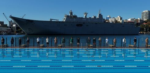 "NAVY LARK: Australia's naval ship HMAS Canberra forms a backdrop as Sydney's Andrew ""Boy"" Charlton swimming pool hosts a men's fashion show. Photograph: Reuters"