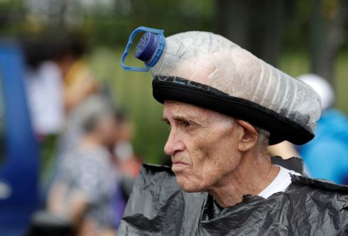 VENEZUELAN UNREST: An opposition supporter looks on with a home-made gas mask on his head during a protest against President Nicolas Maduro in Caracas. Photograph: Reuters