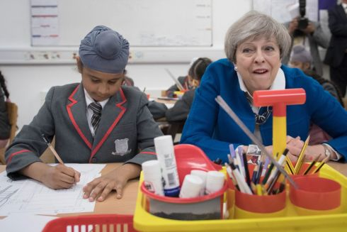 MAY FLIES: Conservative party leader Theresa May with eight-year-old Akaal Singh. Photograph: PA