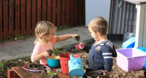 "Children playing in the ""mud kitchen"" of Wigwams Childcare Service, Kilcullen, Co Kildare. Experts say too much screen-time and inactivity is depriving young people of vital lifeskills."