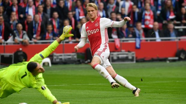 Dolberg scores Ajax's second goal in the first leg win over Lyon. Photo: Toussaint Kluiters/Reuters