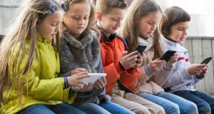"""The simple truth is that if we allow our children to use smart phone technology, we abdicate our responsibility to keep them safe from harm."" Photograph: Getty Images"