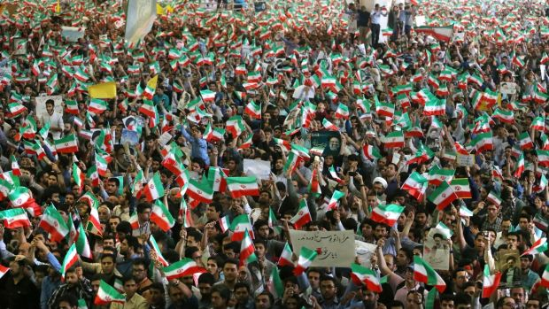Supporters of the Iranian presidential candidate Ebrahim Raisi attend his campaign rally in Tehran. Photograph: AP
