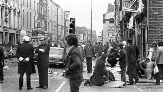 Members of the public tend to the injured following the detonation of a bomb on Talbot Street in Dublin in May 1974. Photograph: Tom Lawlor