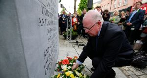 Minister for Foreign Affairs Charlie Flanagan lays a wreath at a commemorative event to mark the 43rd anniversary of the Dublin and Monaghan bombings. Photograph: Nick Bradshaw