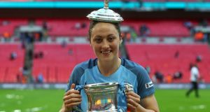 Megan Campbell with the FA Cup trophy after her side Manchester City beat Birmingham City 4-1. Photograph: Kieran Galvin/NurPhoto via Getty Images