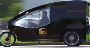 Electronically assisted tricycles, as well as individuals on foot, will be used to deliver packages to and from the container. Photograph: UPS