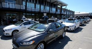 A fleet of Uber's Ford Fusion self-driving cars. Photograph: Aaron Josefczyk/Reuters