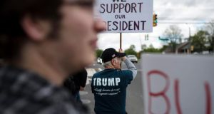 Backing Donald Trump: one of the president's supporters near his golf club in Bedminster, New Jersey, this month. Photograph: Karsten Moran/New York Times