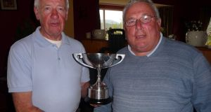 Stuart McGrane, left, receiving the Wicklow Cup following his win on Mask from club vice-chairman, Brian Byrne.