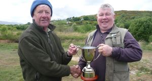 Gary Coughlan, right, being presented with the Lough Conn Trophy by Wicklow Anglers' president Stuart McGrane