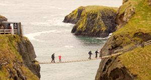 Swinging in the wind: Carrick-a-Rede rope bridge in Co Antrim. Photograph: iStock