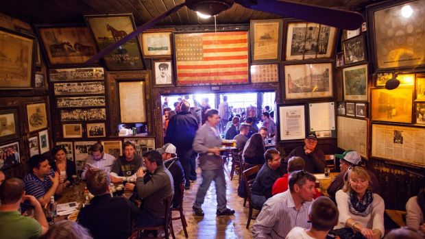 McSorely's Old Ale House: The busy interior, with its portraits, posters, paraphernalia, stovepipe and sawdust floor, is pretty much as it was a century ago. Photograph: mIchael Nagle