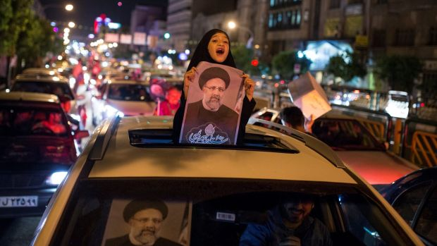 A girl holds a poster of Iranian presidential candidate Ebrahim Raisi during a campaign rally in Tehran, Iran, May 17th, 2017. Photograph: Tima/Reuters
