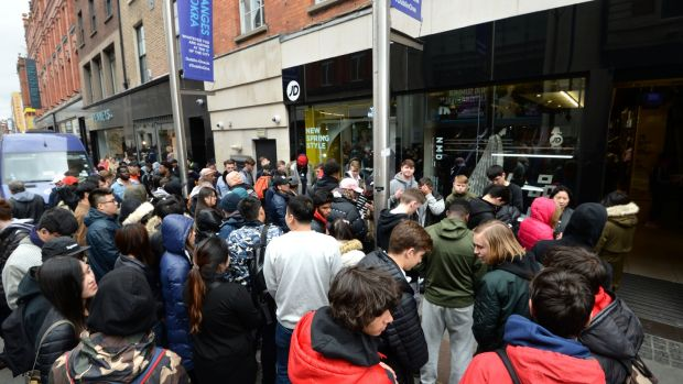 A large number of people queue for Kanye West's Yeezy Boost 350 runners outside JD Sports on Mary Street, Dublin. Photograph: Dara Mac Dónaill