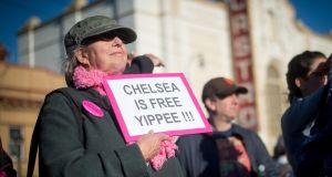 Renay Davis holds up a sign showing support for Chelsea Manning in the Castro District of San Francisco, California on May 17, 2017, during a celebration for Manning's release.   JOSH EDELSON/AFP/Getty Images