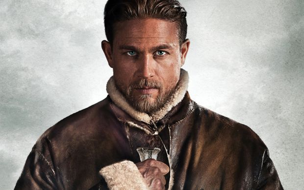 Charlie Hunnam as King Arthur in a promotional still from Guy Richie's reboot