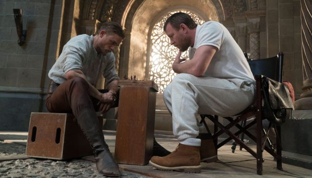 Charlie Hunnam and Guy Richie playing chess on the set of King Arthur: Legend of the Sword