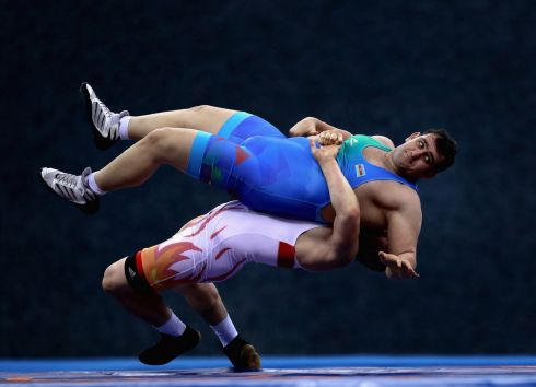 BAKU, AZERBAIJAN: Muminjon Abdullaev of Uzbekistan and Sabah Shariati of Azerbaijan compete wrestle in the fourth Islamic Solidarity Games at the Heydar Aliyev Arena. Photograph: Getty Images