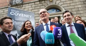 Simon Coveney at the Fine Gael headquarters on Mount Street with Kate O'Connell and Simon Harris where he announced his run for leadership of the party. Photograph: Cyril Byrne/The Irish Times