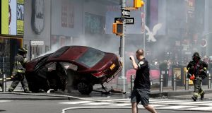 A vehicle that struck pedestrians and later crashed is seen on the sidewalk in Times Square in New York City, US. Photograph: Mike Segar/Reuters