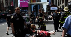 First responders attend to an injured woman after a car plunged into pedestrians in Times Square in New York on May 18th. Photograph: /Jewel Samad/AFP/Getty