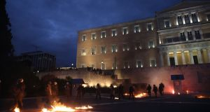 Riot outside the Greek parliament in Athens on Thursday.  Photograph: Costas Baltas/Reuters