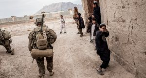An Afghani boy plays at shooting US troops in Kandahar province. Photograph: Bryan Denton/The New York Times