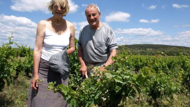 Patrick Masterson with his late wife Frankie, who had unsuccessfully encouraged him to write a novel, in their vineyard near St Chinian