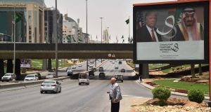 A giant billboard bearing portraits of American president Donald Trump and Saudi Arabia's King Salman in Riyadh. Photograph: Giuseppe Cacace/AFP/Getty