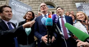 Campaigning: Simon Coveney at Fine Gael headquarters on Thursday. Photograph: Cyril Byrne