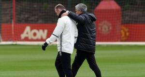 Wayne Rooney  walks with Manchester United's manager Jose Mourinho during a training session at  Carrington on Friday. Photograph: Paul Ellis/AFP/Getty Images