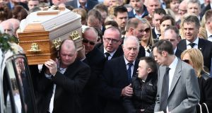 Family and friends follow the coffin during the funeral of Concepta Leonard at St Mary's Church in Brookeborough, Co Fermanagh on Friday. Her son (centre right in jacket) Conor  was treated in hospital for stab wounds.  Photograph:  Colm Lenaghan/Pacemaker