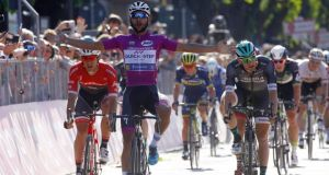 Colombian Fernando Gaviria celebrates as he crosses the line to win Stage 13 of the Giro d'Italia in Tortona  ahead of Ireland's Sam Bennett  (right) in second. Photograph: Luk Benies/AFP/Getty Images