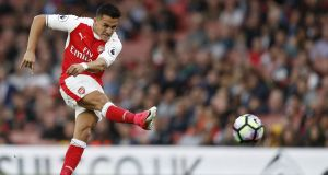 Arsenal's Chilean striker Alexis Sanchez takes a shot at goal during a match against Sunderland this week Photograph: AFP