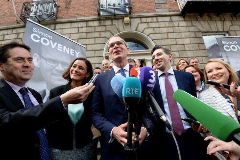 COVENEY CAMPAIGN: Minister for Housing Simon Coveney at Fine Gael headquarters on Mount Street, Dublin, with Kate O'Connell TD, Minister for Health Simon Harris and supporters, where he announced his run for leadership of the party. Photograph: Cyril Byrne/The Irish Times