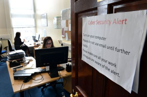HSE ALERT: Cyber security alert notice pinned on doors - in the wake of a ransomware attack that began last weekend - as HSE staff work at Dr Steeven's Hospital in Dublin. Photograph: Dara Mac Dónaill/The Irish Times