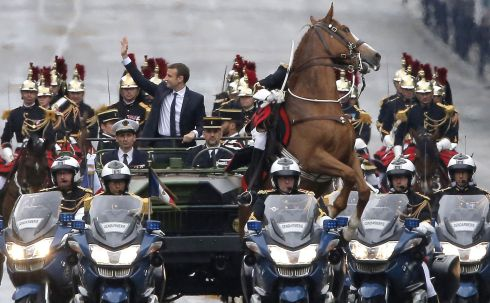 REARING UP: A horse rears up as new French president Emmanuel Macron parades in a car on the Champs-Élysées in Paris after his formal inauguration ceremony. Photograph: Michel Euler/AFP/Getty Images