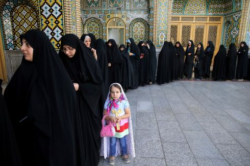 IRAN VOTES: Iranian women queue to vote in presidential and municipal council elections in the city of Qom, south of the capital, Tehran, Iran. Incumbent Hassan Rouhani faces a staunch challenge from a hard-line opponent over his outreach to the West. Photograph: Ebrahim Noroozi/AP Photo