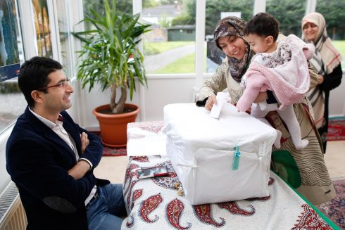 DIASPORA VOTES: Members of the Iranian community in Ireland cast their votes in Iran's presidential election at the Embassy of the Islamic Republic of Iran, Dublin. Rehane Amrollahi with her 10-month-old daughter Kowthar, from Cork, is shown casting her vote. Photograph: Kenneth O'Halloran