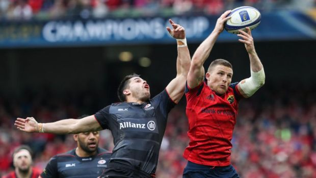 Andrew Conway challenges Saracens' Sean Maitland during Munster's Champions Cup semi-final defeat to the English side. Photograph: Billy Stickland/Inpho