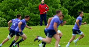 Director of rugby Rassie Erasmus casts an eye on Munster training at the University of Limerick. Photograph: James Crombie/Inpho