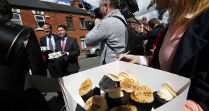 Lifting the cup(cake): Fine Gael leadership candidate Leo Varadkar  and  Paschal Donohoe  serve up coffee and cupcakes on Leo Street in Dublin, as Donohoe announces his support for Varadkar.  Photograph: Sam Boal/RollingNews.ie